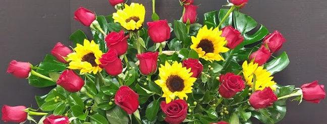 Sunshine basket. roses and sunflowers basket.
