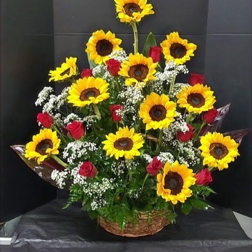 Sunshine love: Sunflowers and roses in  basket,