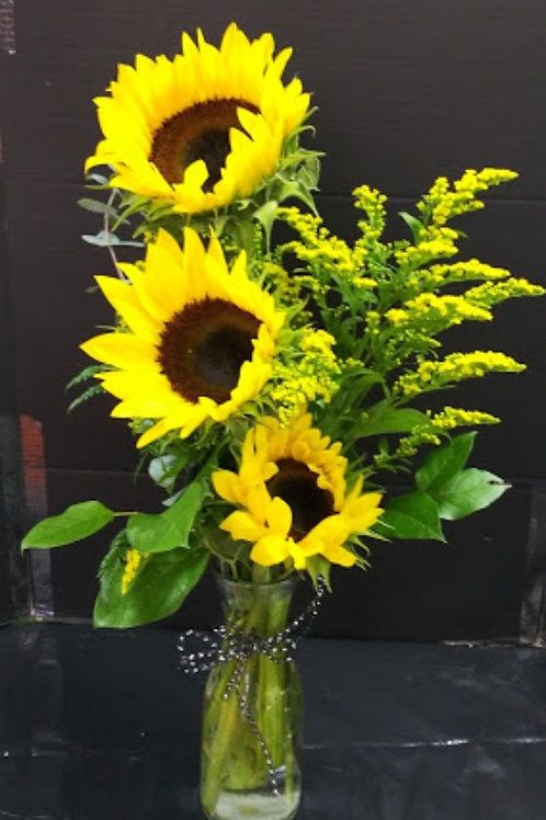 Sunflowers, beautiful sunflowers in a crystal vase.