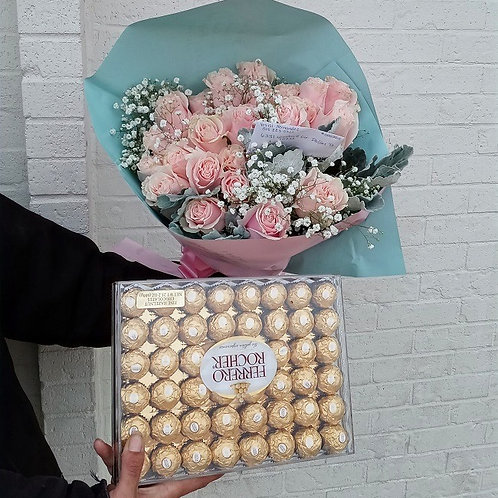 24 light pink roses and chocolates.
