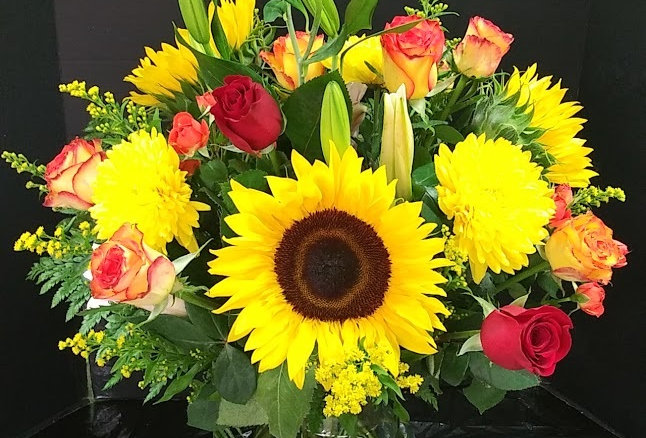 Bright Flowers, beautiful yellow and orange flowers in  vase.