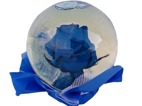 Blue real rose in crystal globe, beautiful blue rose inside a glass ball.
