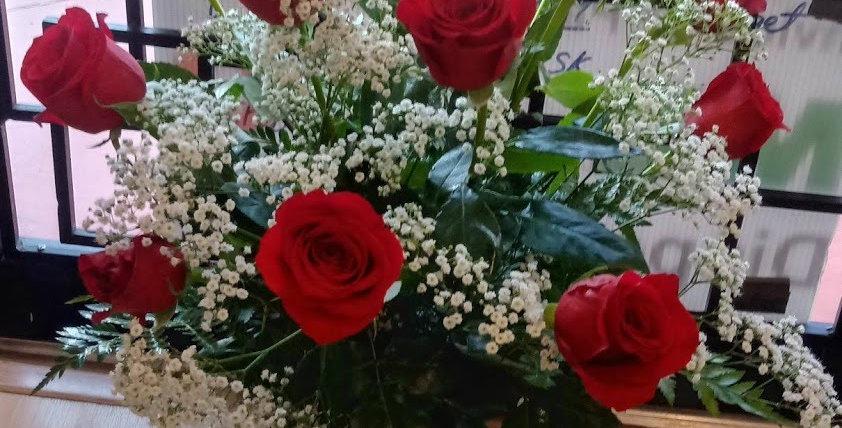 Dozen of roses in a crystal vase.