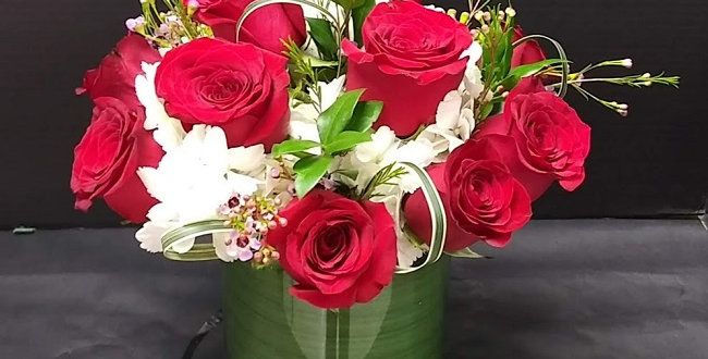 12 red diamonds in a vase, red roses in a vase.