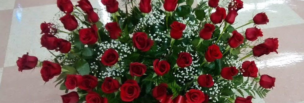 Big basket with a lot of roses, five dozens of roses