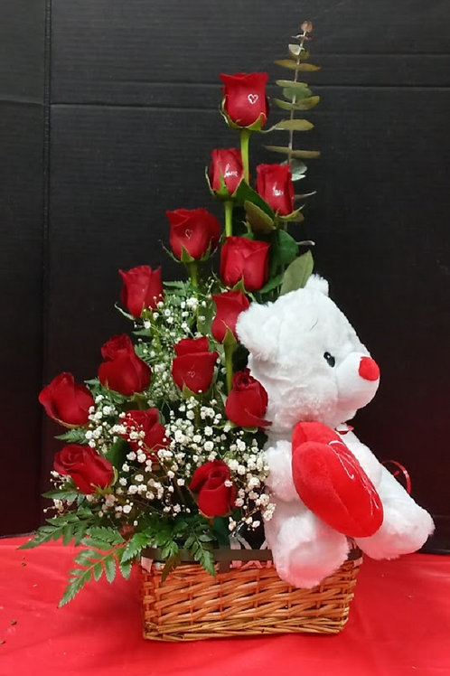 Love in a basket, red roses and teddy bear in a basket