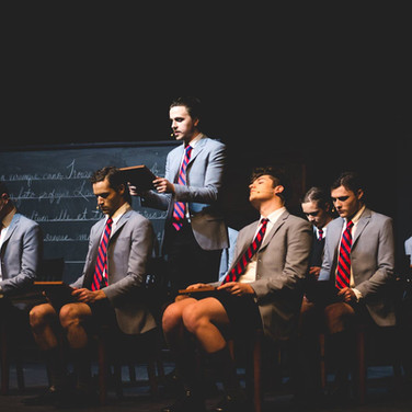 """Production photo from Theatre Western's """"Spring Awakening,"""" in which I played Hanschen and read latin off a mini chalkboard, as pictured."""