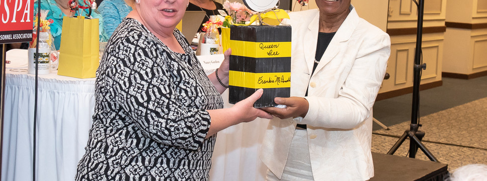 Vice President Lorraine Johnson, Prince George's County, presenting Secretary Frankie McDonnell with the Queen Bee Award
