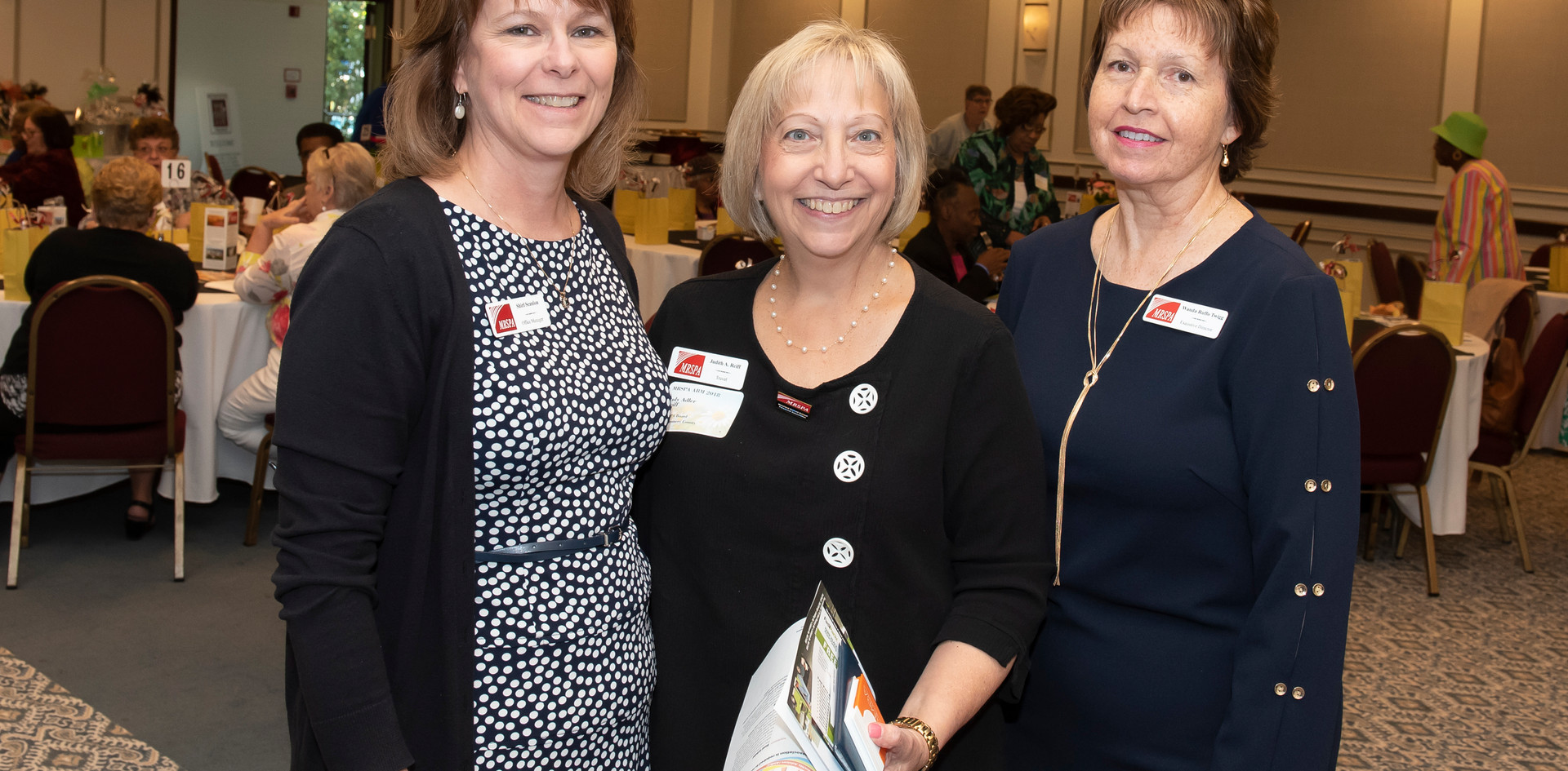 Office Manager Shirl Scanlon, Travel Chair Judy Adler Reiff, and Executive Director Wanda Twigg