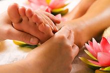 Woman enjoying a feet massage in a spa s