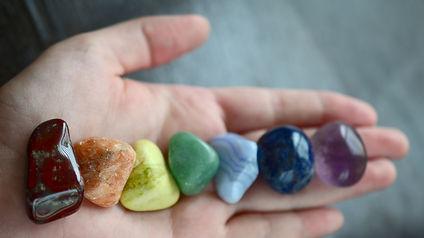 Rainbow Healing Crystals on wood table.