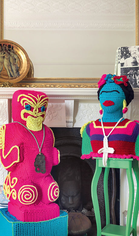 3D sculpted crochet tiki and Freida Kahlo in neon pink and yellow