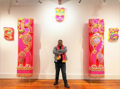 Man standing in front of art
