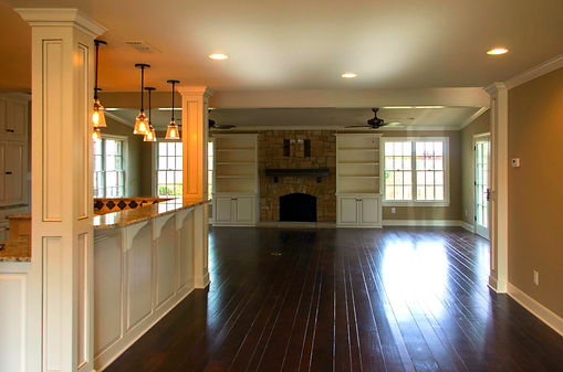 Fireplace; wood floors; custom cabinetry