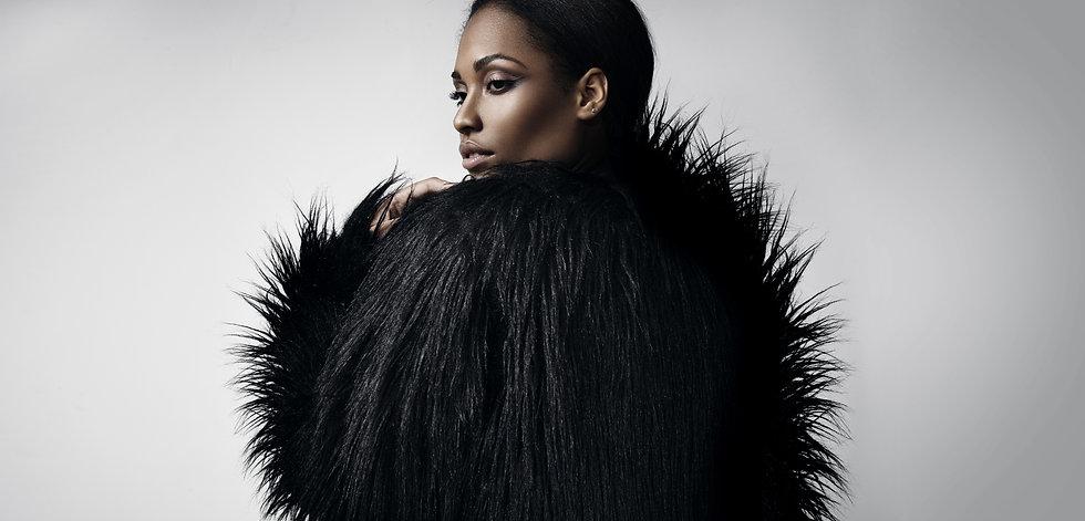 Black women in fur coat.jpg