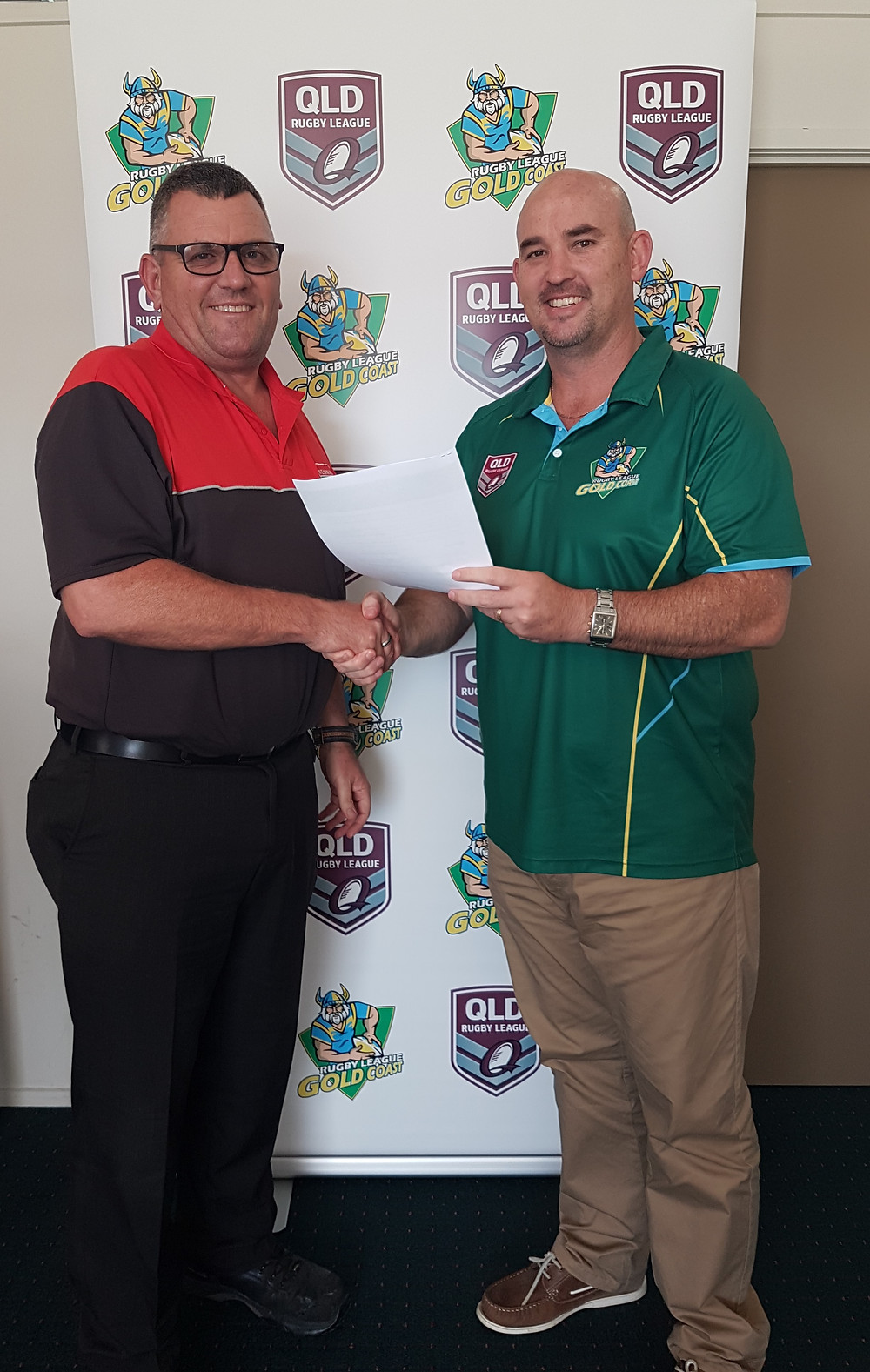 Kennards Hire Area Manager Steve shaking hands with RLGC Manager Scott Dunshea