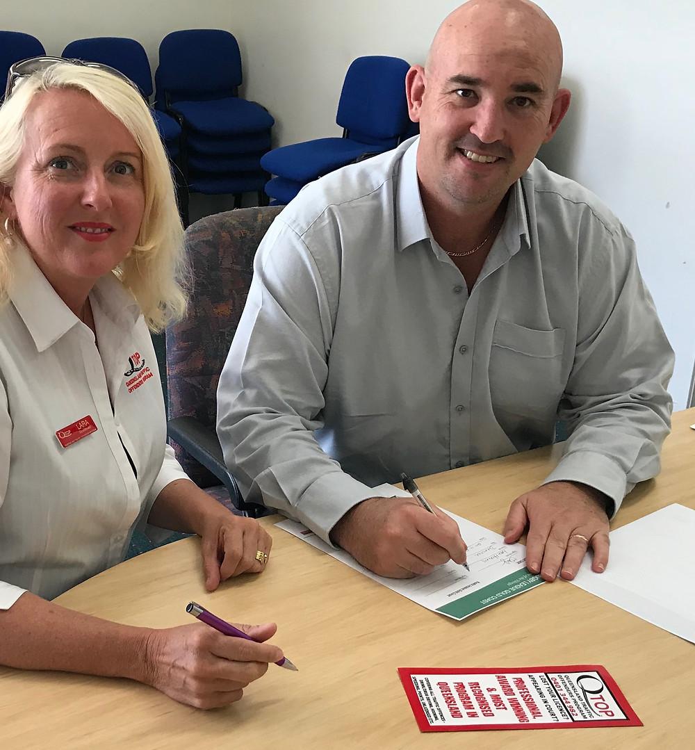 QTOP/QTEP Director Lara signing agreement with RLGC Manager Scott Dunshea