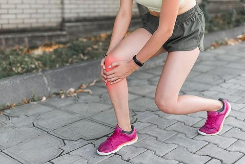 female-athlete-having-pain-knee.jpg