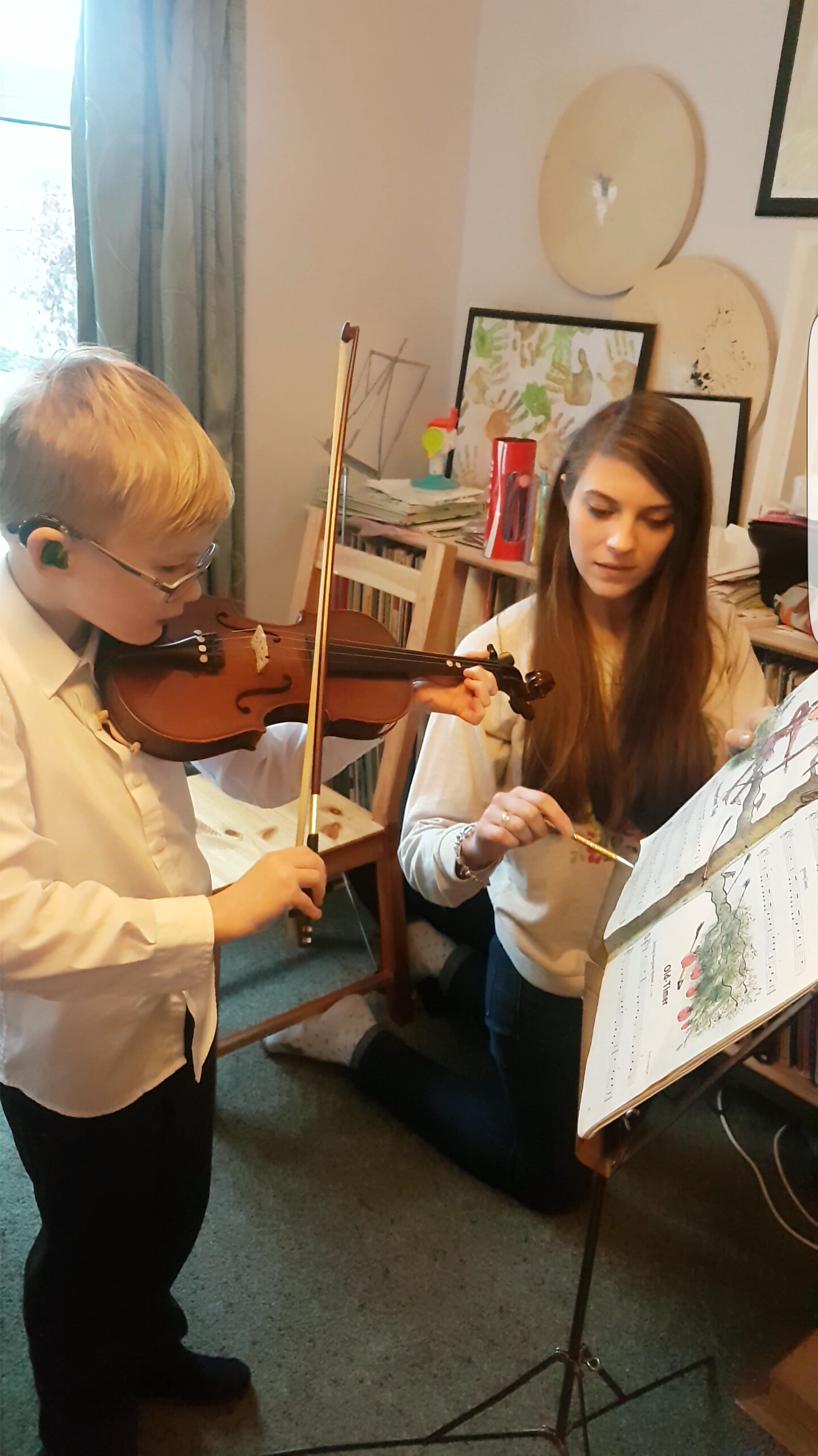 Eloise Teaching Violin