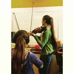 Eloise Teaching Violin