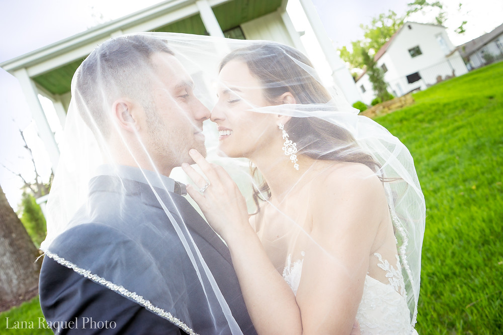 Bride and Groom under veil at Historic Estate