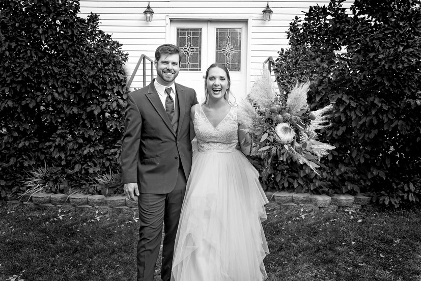 Black-and-White-Bride-and-Groom-Exiting-Chapel
