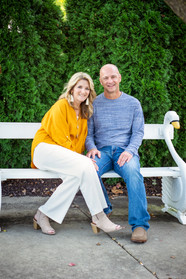 Husband and Wife Sit on a Garden Bench