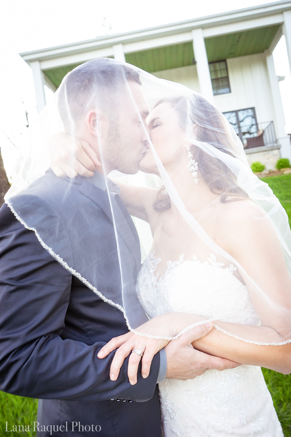 Bride and Groom under a veil at Historic Estate