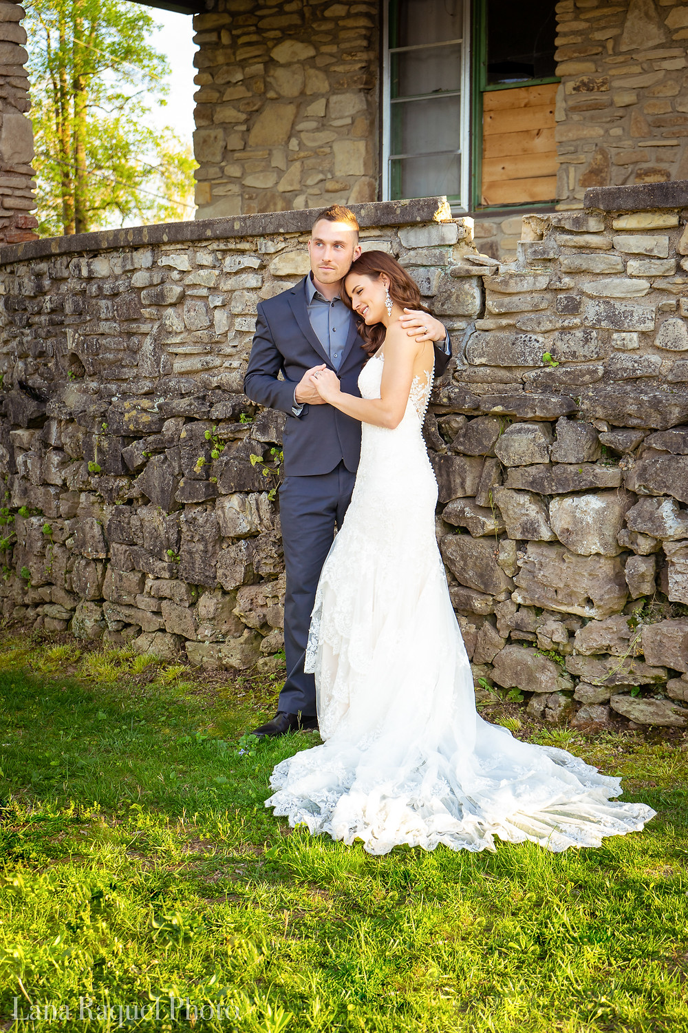 Bride and Groom Cuddle at Estate