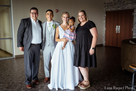 Bride-and-Groom-With-Pastor