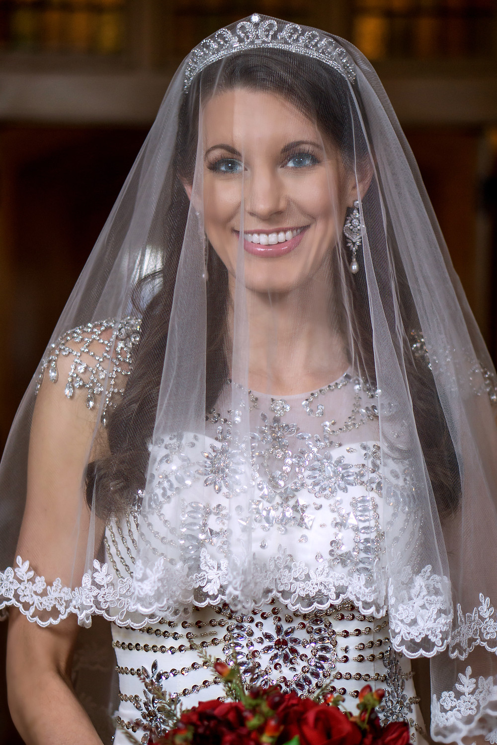 Smiling Bride wears crown and veil close-up