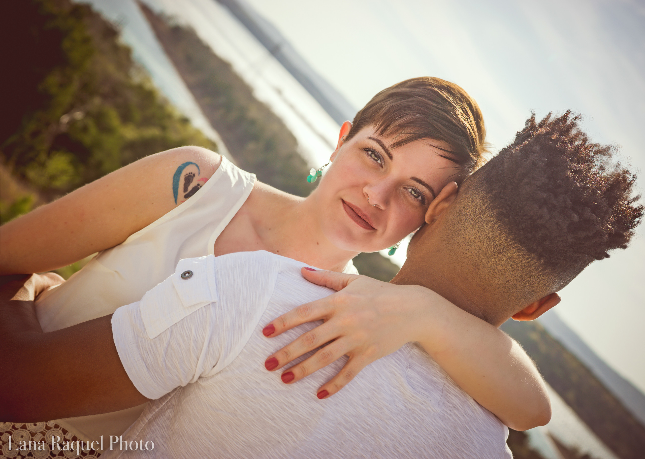 Couple embraces by the Lake
