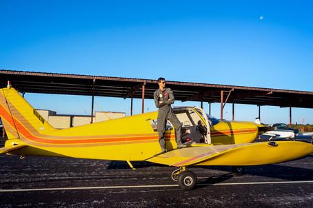 Male Senior Portrait with Plane