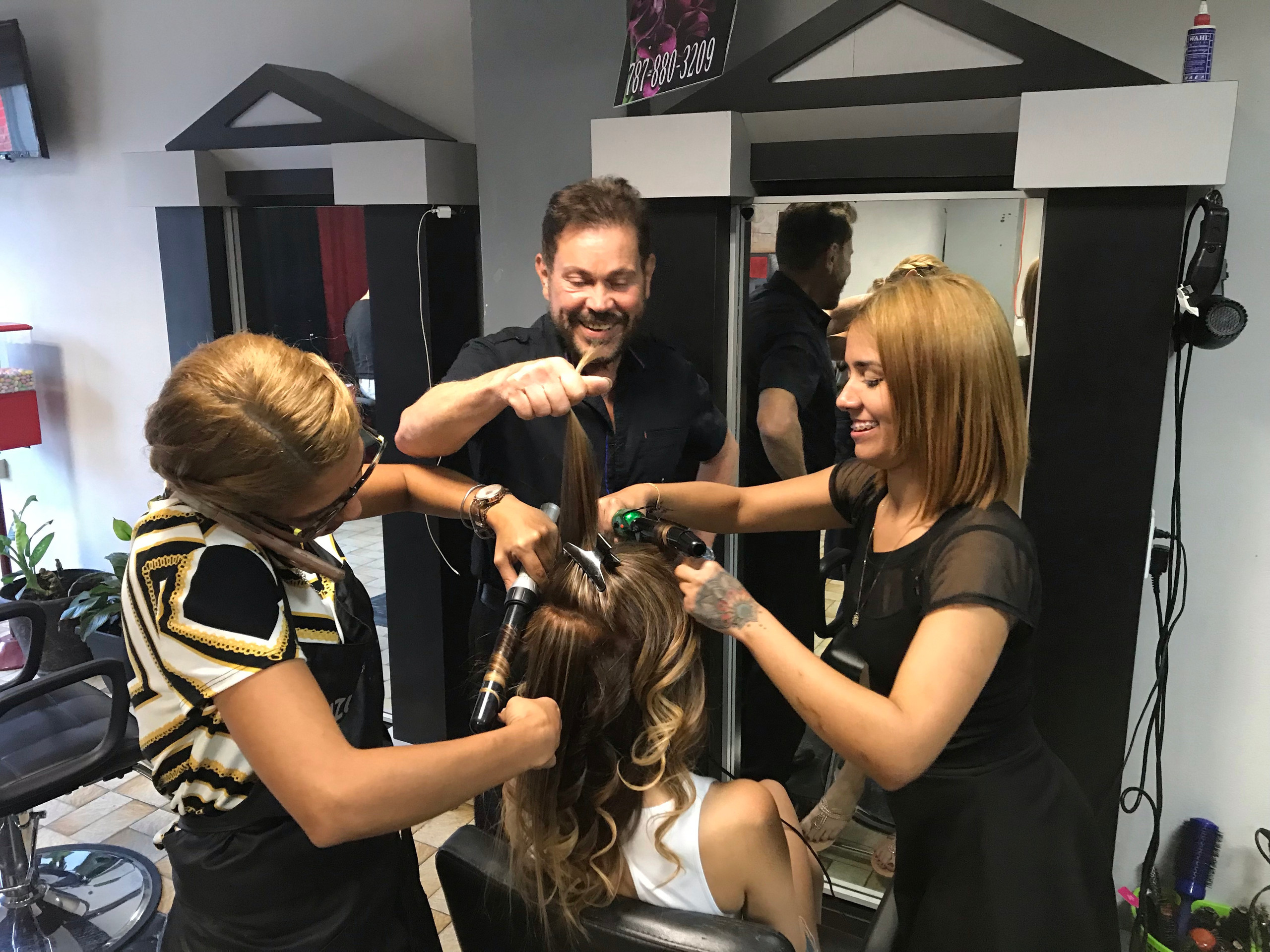 Three stylists do hair in Puerto Rico