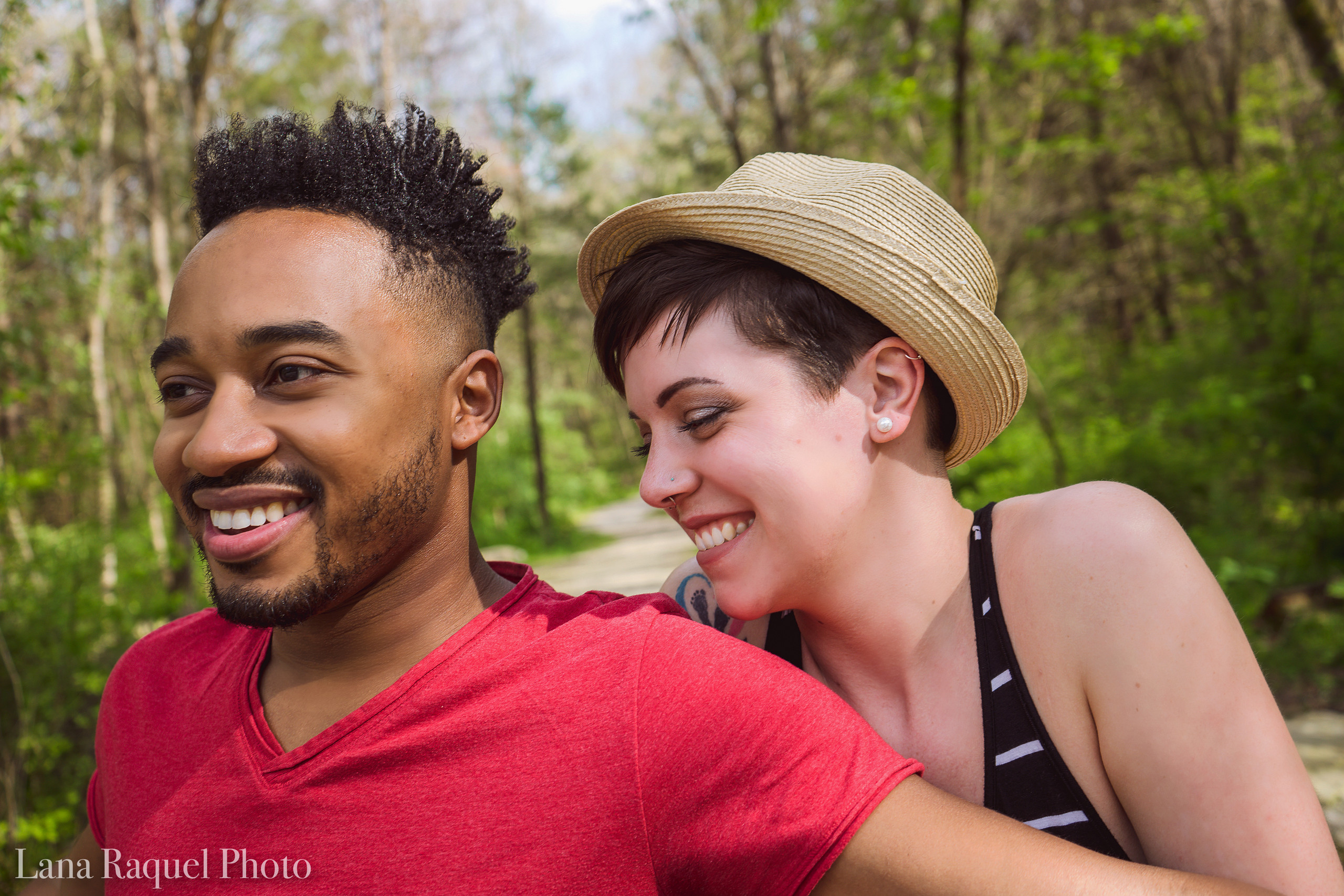 Interracial Couple Laughing in the Woods