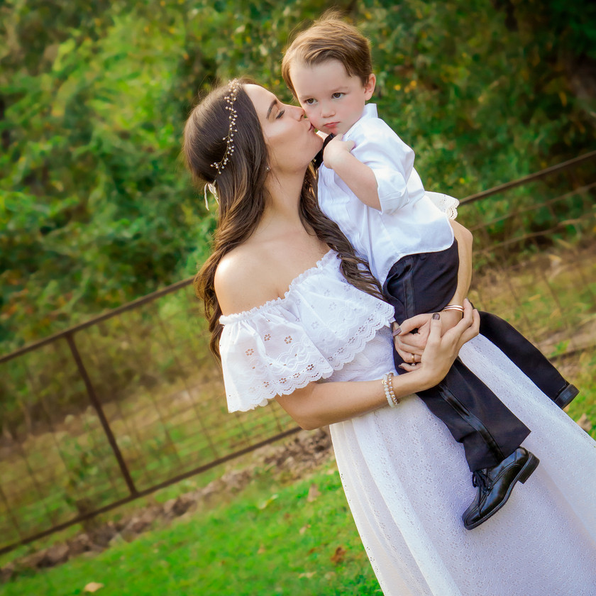Bride Kisses Nephew on the Cheek