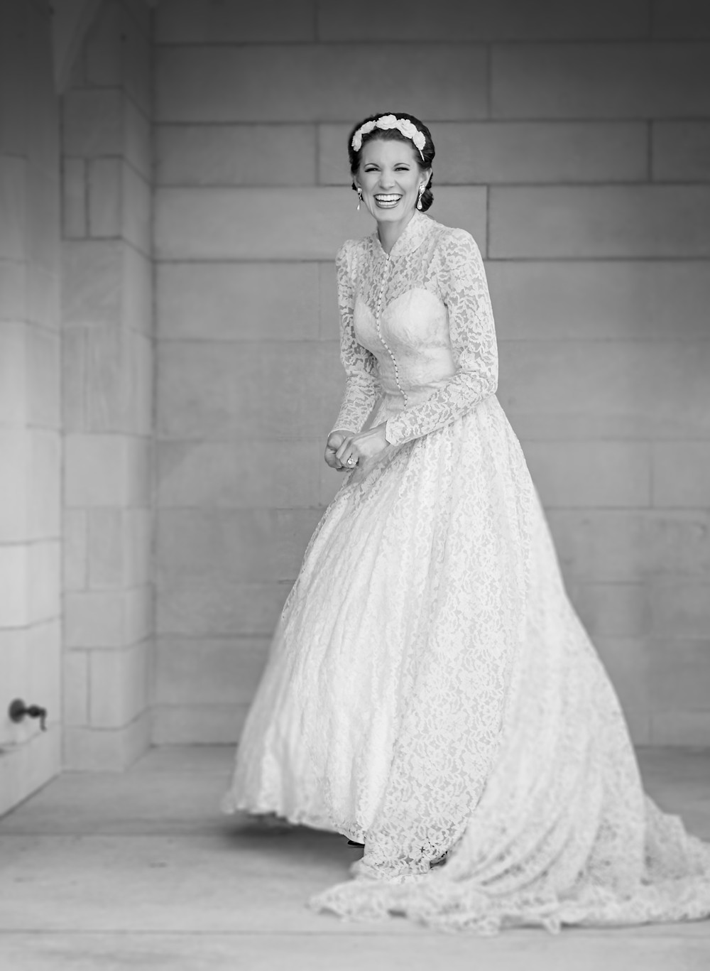Bride laughs wearing vintage dress