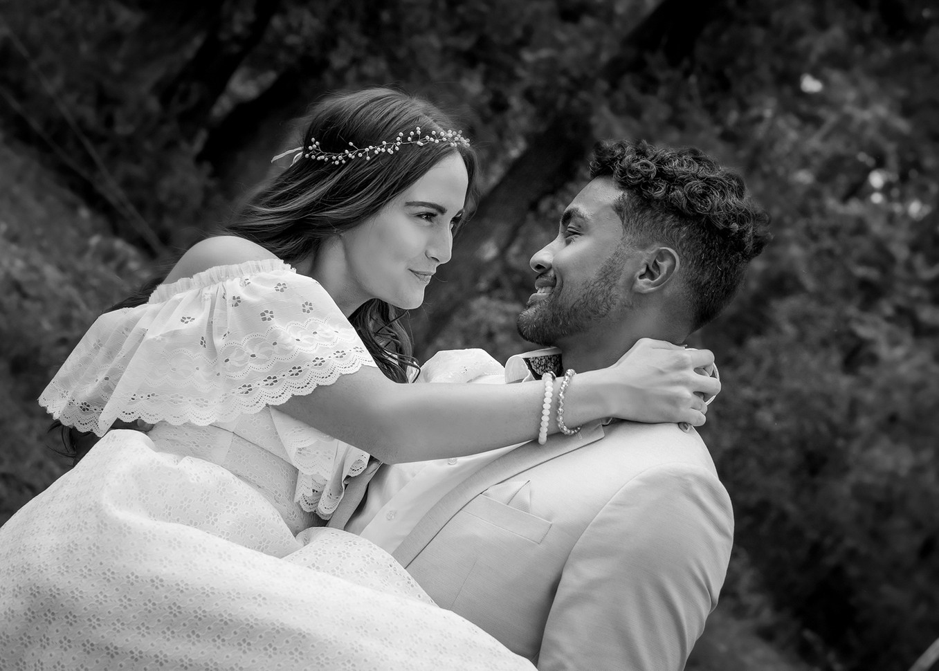 Black-and-White-Shot-Of-Groom-Carrying-Bride