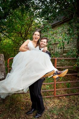 Groom-picks-up-laughing-Bride