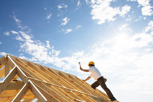 male roofer carpenter working on roof st