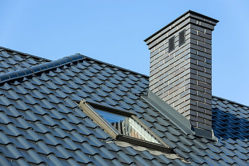 Roof of a detached house with a skylight