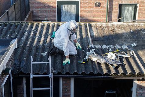 Professional asbestos removal. Men in pr