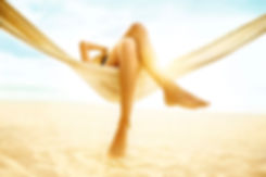 woman-relaxing-in-hammock-on-beach-17045