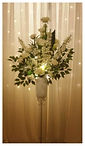 Beautiful pedestal stands filled with masses of cream and white flowers and foliage