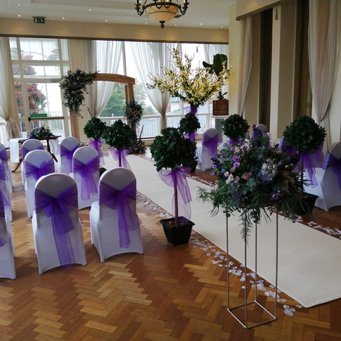 Bay trees, white Chair Covers and Organz