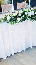 LED Table Skirt and hanging end posies.j