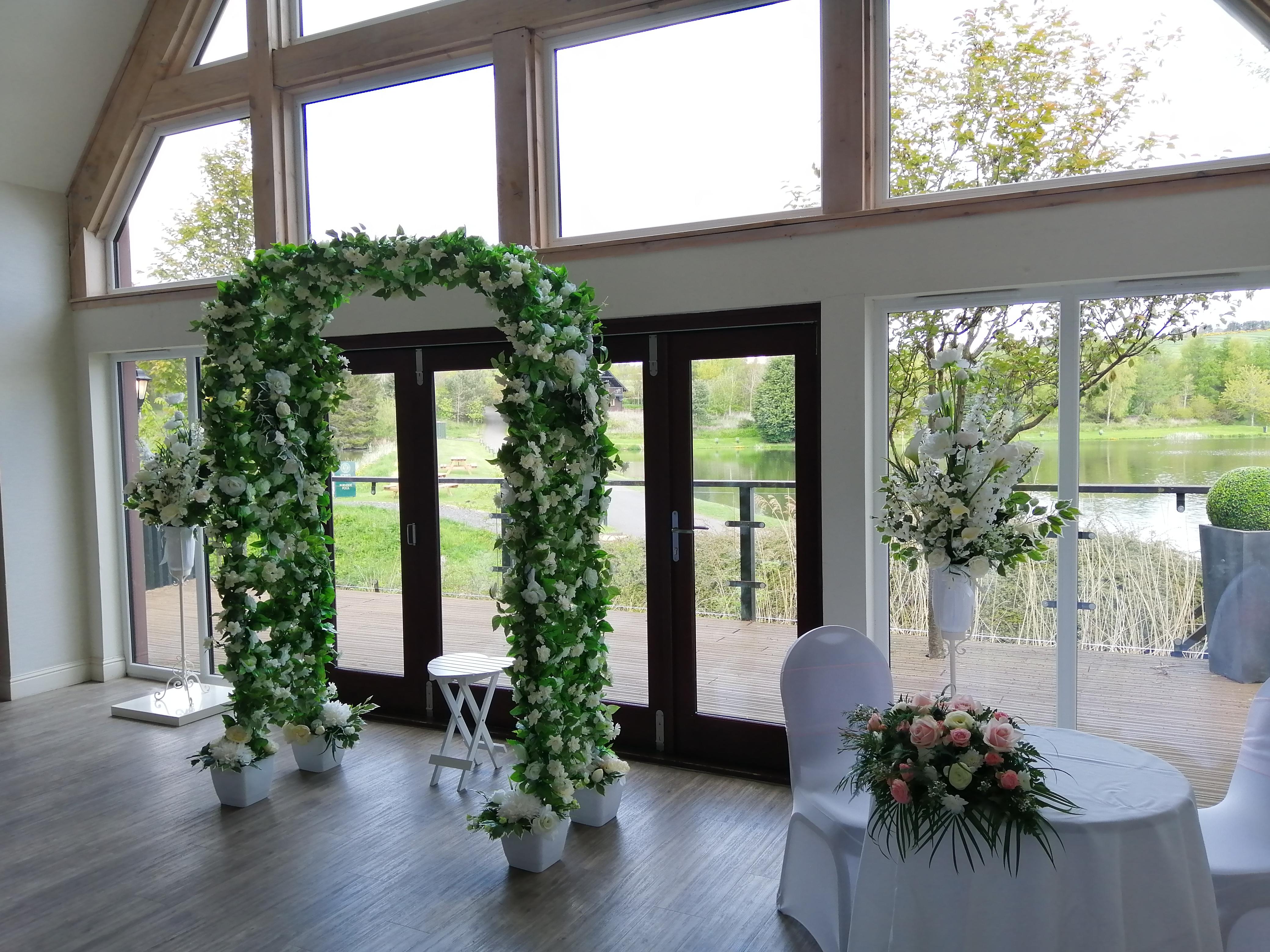 Archway and Pedestal Flower Arrangements