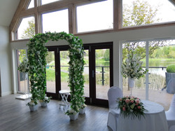 Archway and Pedestal Flower Arrangements