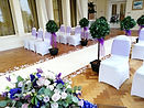 Aisle Runner with bay trees and scattered rose petals