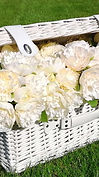 White wicker basket with peony flowers